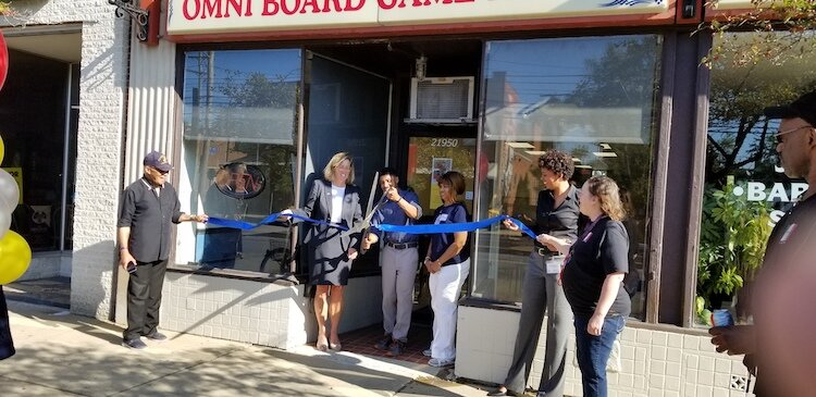 Jason Gardner celebrates the ribbon cutting with Mayor Kirsten Holzheimer Gail and other Euclidians.