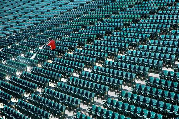 Cleaning the seats at Progressive Field