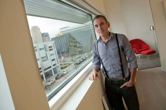 John Owens in his Uptown apartment with a great view of MOCA
