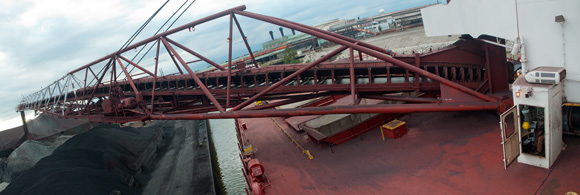 The iron ore is removed from the freighter's hold via a conveyor belt and then transferred to shore on a 250-foot boom