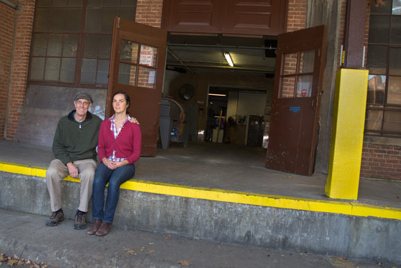 Molly Murray, with her father Patrick Murray, on the loading dock of the 100-year-old Hildebrandt Building, future home for Wake Robin Fermented Foods