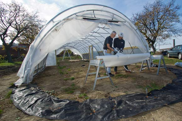 Carlton Jackson and Todd Alexander, co-owners of Tunnel Vision Hoops working on a hoop house in Ohio City