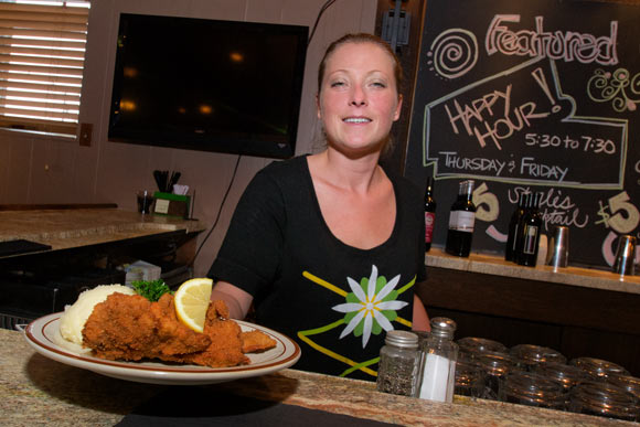 Kimberly Bork of Sterles Country House serves up a plate of Weinerschnitzel