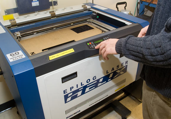 The Epilog laser cutter at Think[box]