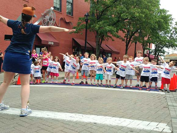 The 2013 Ohio City Kids Dash warm up prior to the 130 meter dash -  photo Ashley Taseff