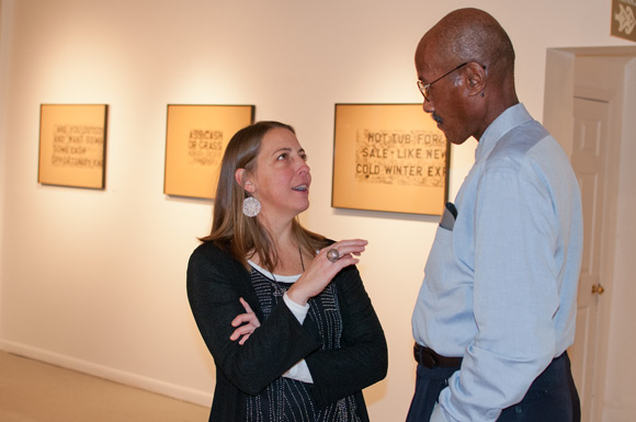 Artist Liz Maugans chats with photographer Dale Goode at their exhibition at Arts Colinwood
