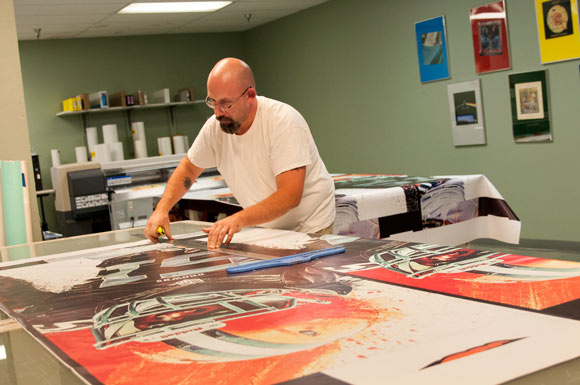 Working on Browns banners at Morgan Litho