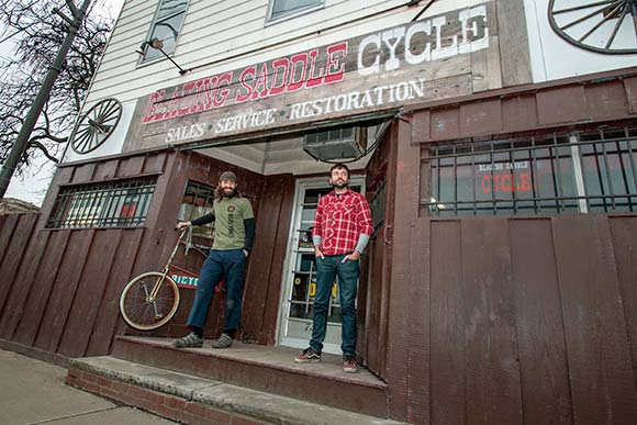 Travis Peebles and James Rychak, co-owners of Blazing Saddle Cycle west side location