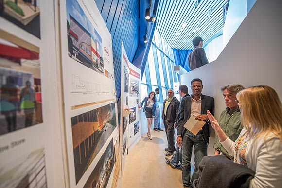 Current CIA senior Interior Architecture student Quentin Spencer showing his designs to visitors at the 2014 Spring Design Show