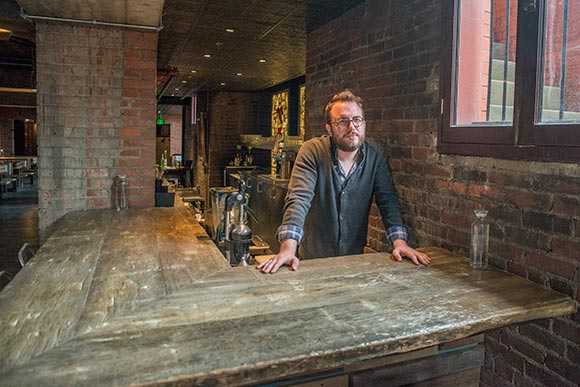 Bar top at The Spotted Owl by (ARC)form, Will Hollingsworth owner pictured
