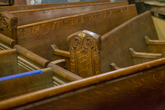 Old church pews at Old School Architectural Salvage Project
