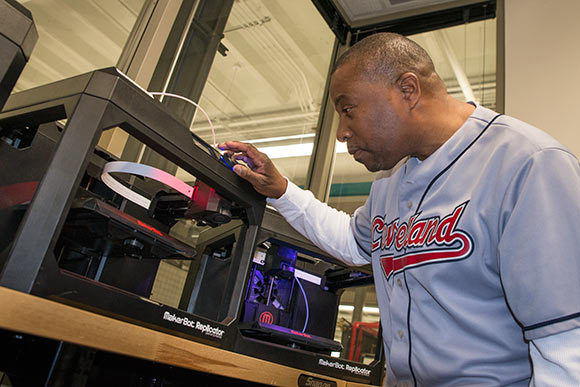 Student operating a 3-D printer at at Tri-C's Unified Technologies Center at Tri-C
