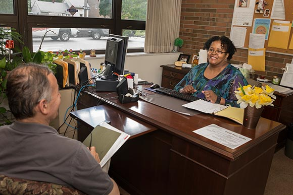 Joyce Jones, Case Manager helping Juan Rios Soto with employment at The May Dugan Center