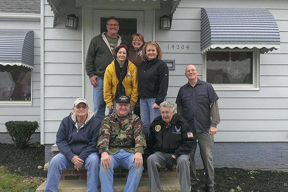 CAVA helped furnished a home purchased by this 17 year Veteran shown here (in yellow) with are volunteers from local VFW's & Veteran groups