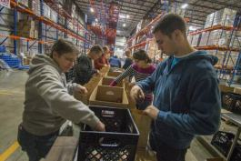Volunteers at The Greater Cleveland Food Bank packing lunches for After School Programs