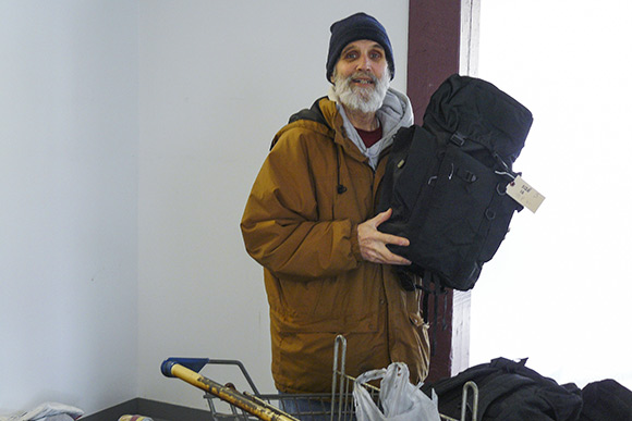 Jim Schlecht, outreach worker for NEOCH, taking donated items out to homeless people in Cleveland