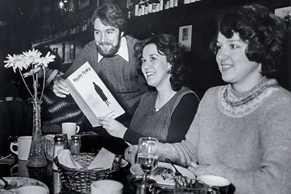 Nighttown, 1977: Nighttown manager Robert Durrin hands a dinner menu to a patron.