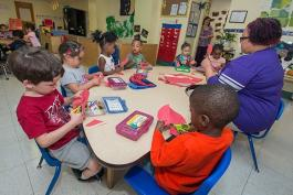 Teacher Anita Wilson working with Pre4CLE students at St. Augustine Child Enrichment Center
