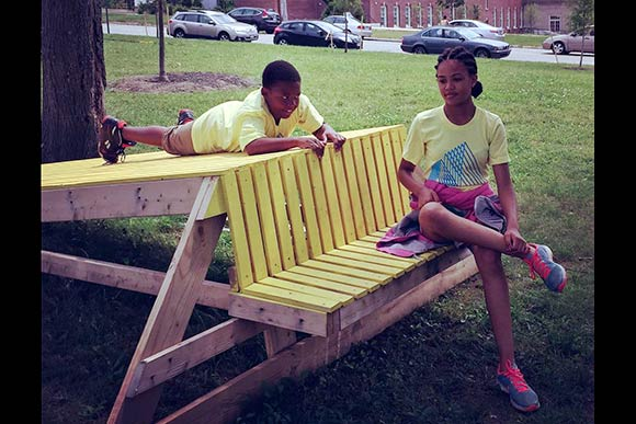 Johnathan Streeter and Zoe McClain-Ferrell checking out  the Stoop Slides constructed by MOOS