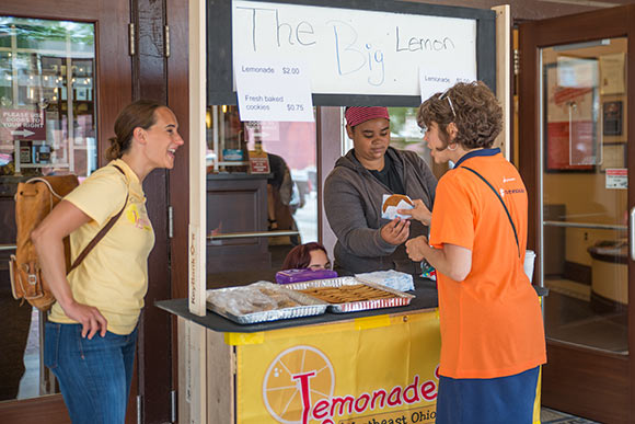 Student entrepreneurs lemonade stand outside the Capitol Theatre