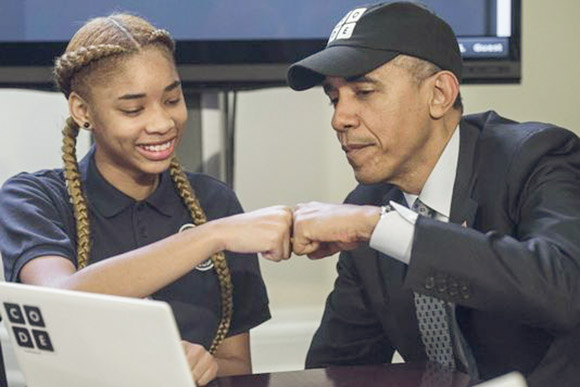 President Obama with a middle school student in an Hour of Code Event put on by Code.org at the White House in 2014