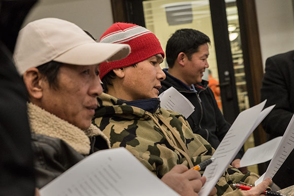 Nepali refugees practicing their English at the Welcome Hub