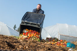 Chris Bond, Farm Horticulturist at CWRU Squire Valleevue Farm empties the waste brought in for composting