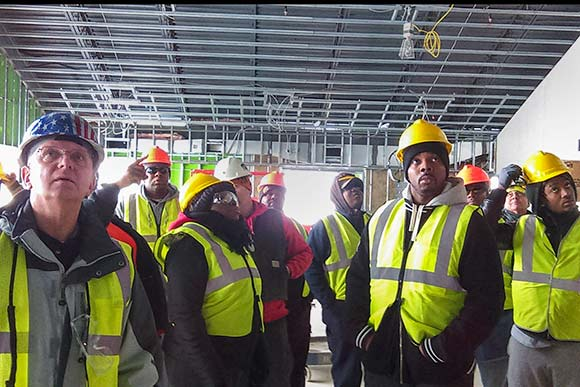 PAT class on a construction site tour with Tri-C instructor Gene Stapanek
