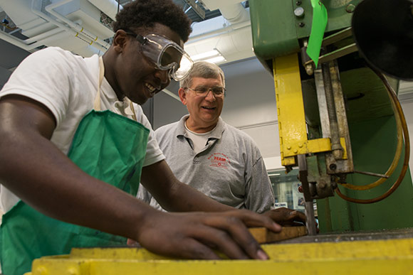 Max Hayes instructor Anthony Kazel, a 40-year veteran of the school's machine shop with student Devonta Edmonds
