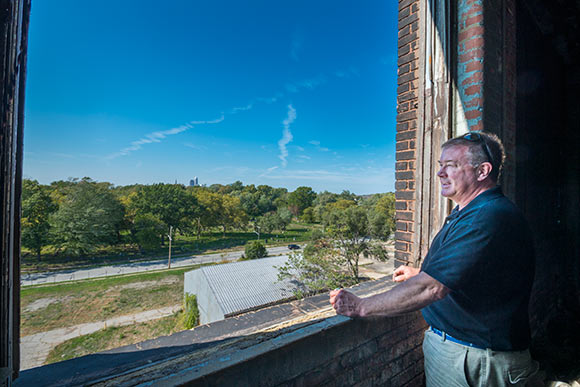Developer J. Shorey looks out  at the neighborhood and city from the top floor of the Foundry Project bldg