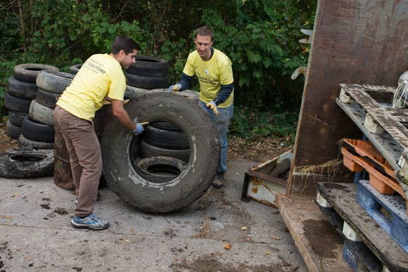 Ernst & Young volunteers gathered for a cleanup of the Euclid Railroad-Green Creek Corridor