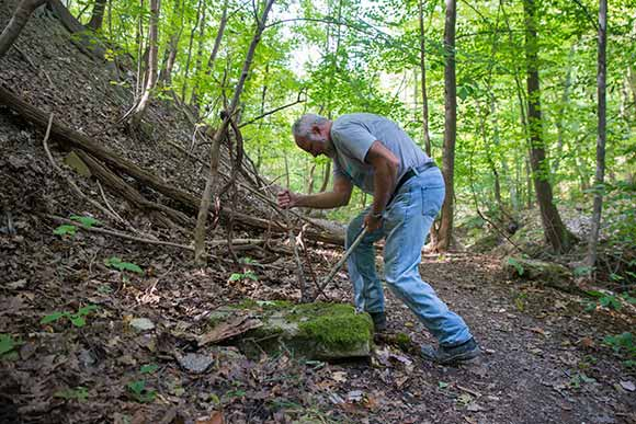 Paul Beno cutting and removing a twisted piece of rebar along the path