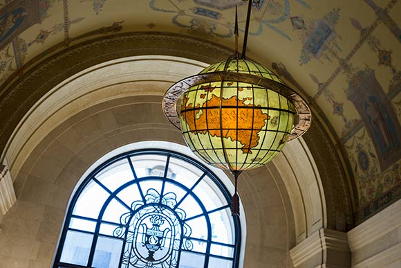 The restored 1926 terrestrial globe above the entrance at the Cleveland Public Library