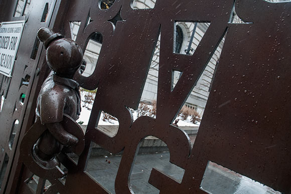 The bronze gate by artist Tom Otterness, with its fragmented alphabet, and whimsical characters