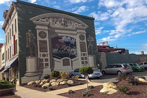 An Eric Grohe mural in downtown Massillon