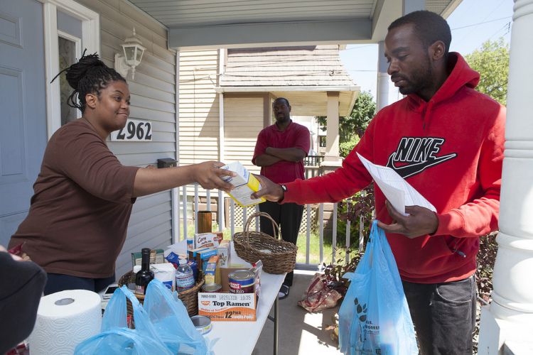 Dawn Arrington and her family conduct a Food and Amenity Exchange on her front porch