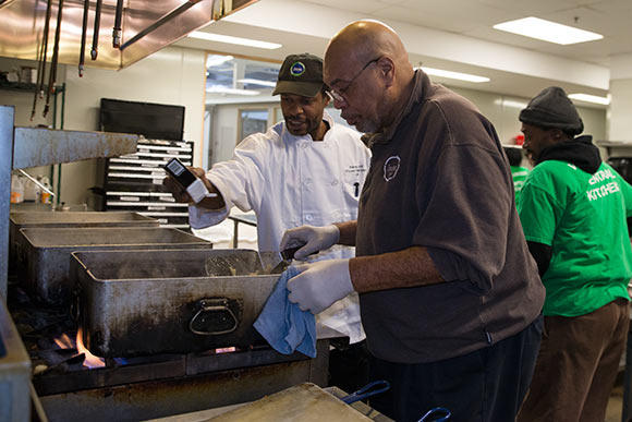 Brad Taylor, Kitchen Manager, works with a trainee in the Culinary Training Program at Lutheran Metropolitan Ministries