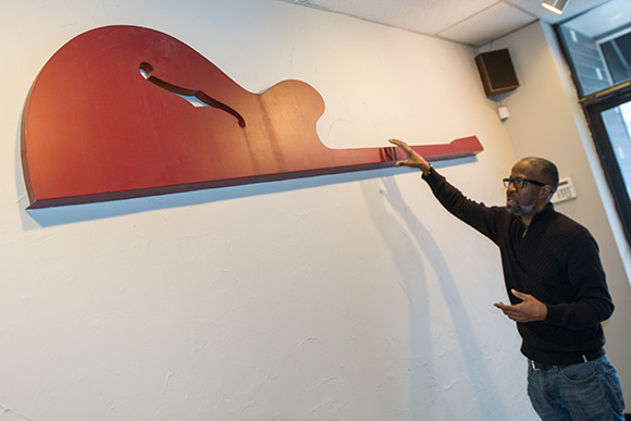Part of the original sign from Heights Guitars hangs proudly in the new Heights Music Shop