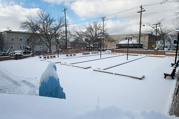 Snow covered bocce courts at Alta House