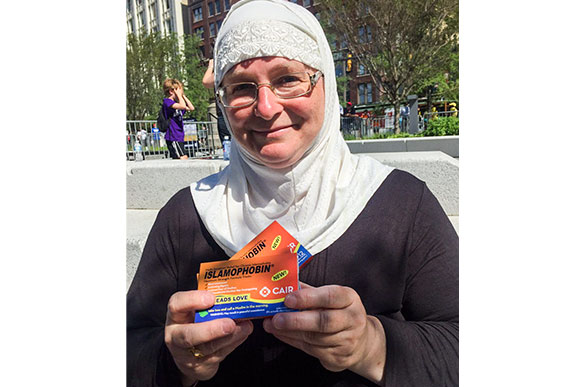 Julia Shearson of CAIR-Cleveland offering passers by 'Islamophobin,' to treat intolerance