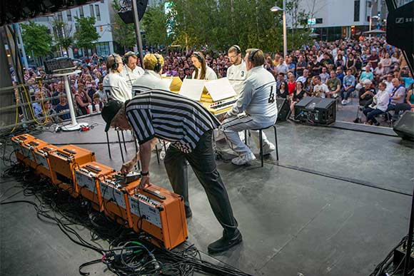 Mark Mothersbaugh, forefront, and the Music For Six Sided Keyboard concert at MOCCA
