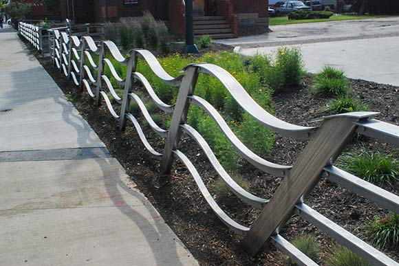 The Wave sculptural fence draws its form from the imagined wave vibrations of nearby Lake Erie