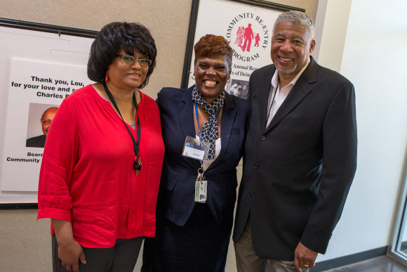 Tomeka Ewing (center) with case worker Barb Wilson (left) and LMM Executive Director Charles See
