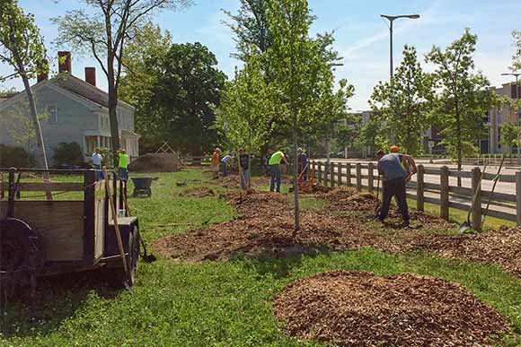 Volunteers from Fairmount Santrol helped plant trees at the Dunham Tavern site last May in Cleveland as part of a beautification effort
