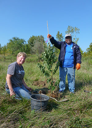 Alcoa And Western Reserve Land Conservancy Volunteers Plant Trees At