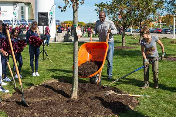 Former Cavs player Campy Russell helps out with the Trees for Threes program recently at the Great Lakes Science Center