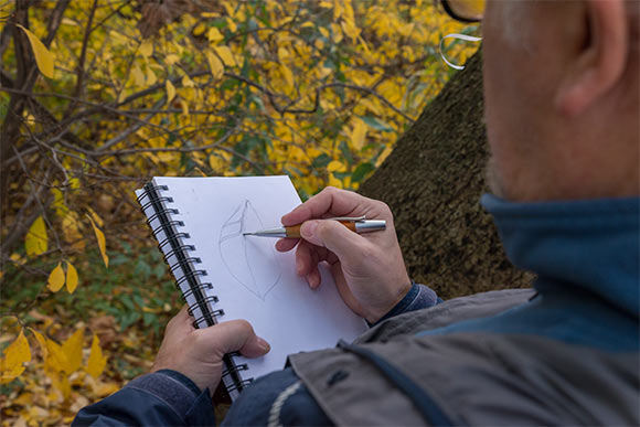 Douglas Paige making a sketch in his field notebook