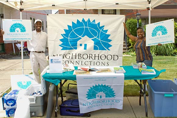 Todd Kennedy, a member of the Grant Making Committee, and Cynthia Lewis, grants manager, promote Neighborhood Connections at a neighborhood festival