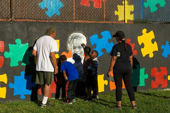 Volunteers putting the Chelton Park mural project pieces together