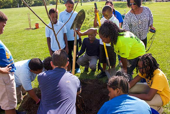 Kids from Kinsman neighborhood planting trees